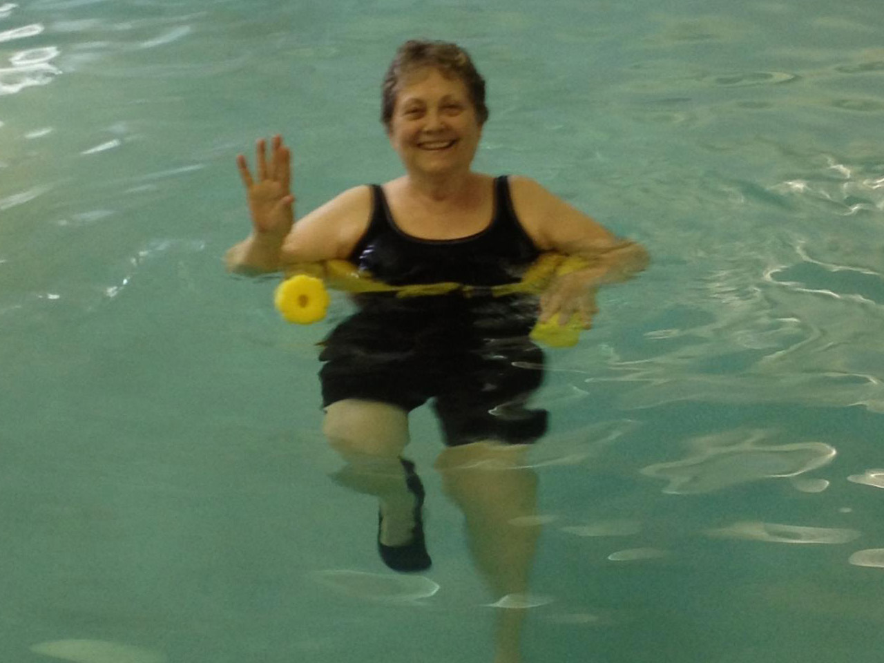 Sue in water aerobics